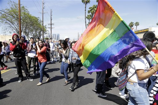 "Students rally outside Santee Education Complex in South Los Angeles on Wednesday, April 20, 2016. The principal of the Los Angeles high school where a scuffle broke out with adult protesters over a new gender-neutral bathroom praised his students Wednesday as ""trailblazers"" for campaigning to install the restroom. Bathrooms for transgender students have become a focal point in the national debate over anti-discrimination laws. (AP Photo/Nick Ut)"