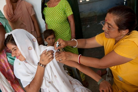 Auxiliary Nurse Midwife, Shobha Devi (centre) gives Pushpa (left) a tetanus injection at the Anganwadi centre as part of the Government of India's NRHM programme, on the outskirts of Delhi. Photo: Sanjit Das for The Bill and Melinda Gates Foundation
